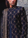 Black silk fully embroidered sherwani with antique gold embroidery and crushed silk stole.